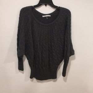 Trina Turk dark gray cable knit sweater.